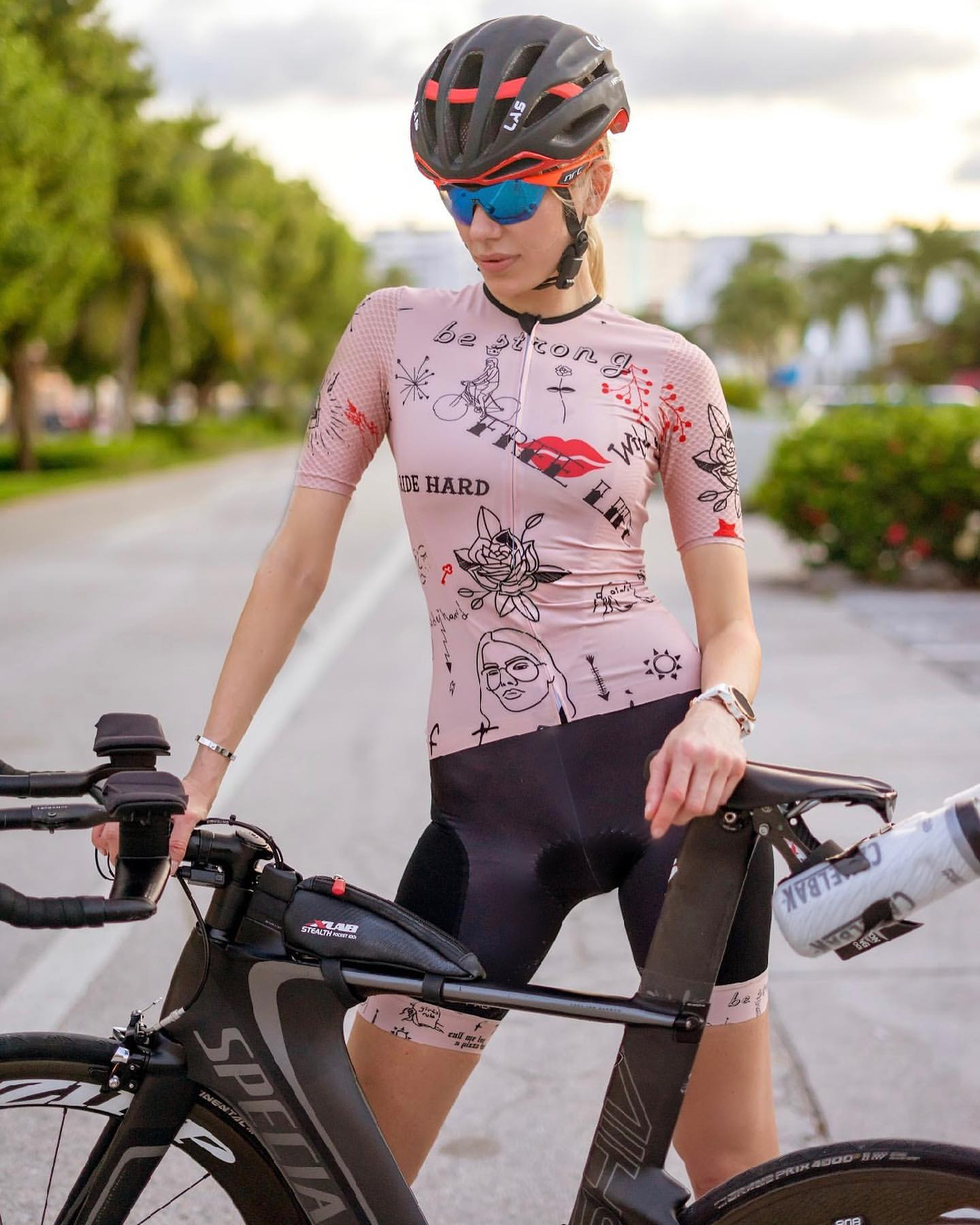 Nadezhda Pavlova standing in Girls Rule pink cycling kit