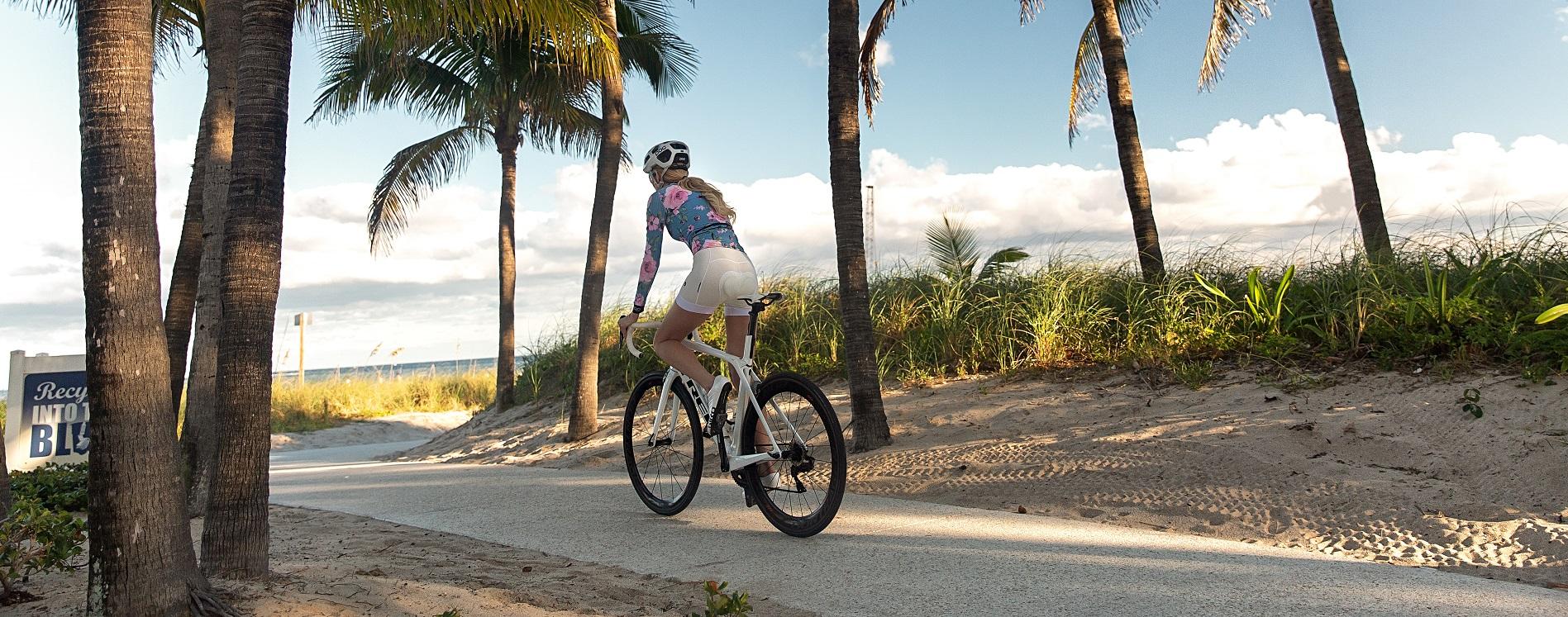 Nadezhda Pavlova riding bike on beach road in Florida
